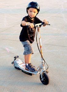 boy-standing-on-scooter
