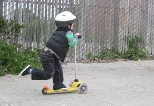 little-boy-on-a-3-wheel-scooter