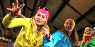 3 women wearing colorful ski attires
