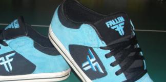 fallen skyblue skateboard shoes on green background