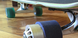 huge wheels on an electric skateboard resting on the wooden floor