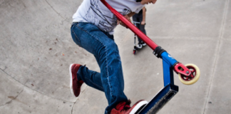 pro scooter rider performing a stunt