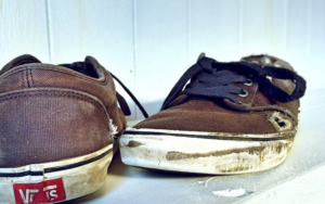 worn out brown skate shoes