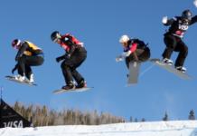 Snowboard cross participants photo on air