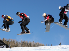 Snowboard cross participants photo on air