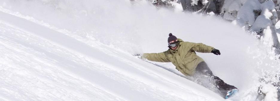 Snowboarder's sharp turn