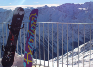 Snowboards resting on the terrace above the mountain