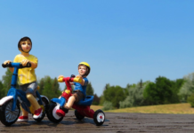 action figures of kids riding bikes on a park
