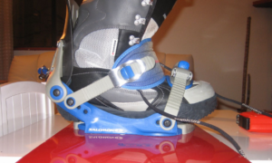 blue bindings on a red snowboard