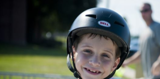 boy smiling wearing his blue helmet