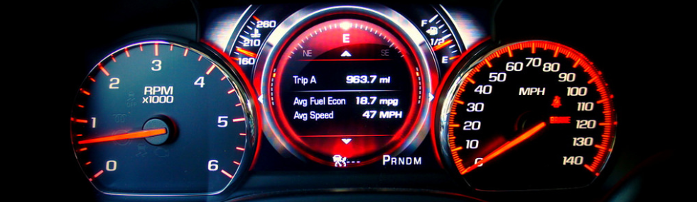 driver's gauges on speed and acceleration