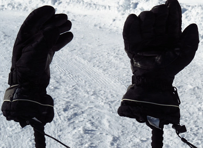 gloves resting on top of skis