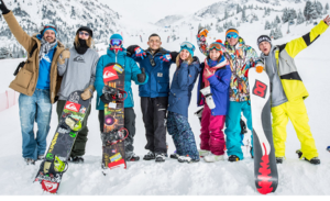 group of snowboarders posing for a picture