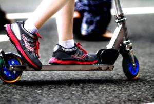 kid on a chrome kick scooter