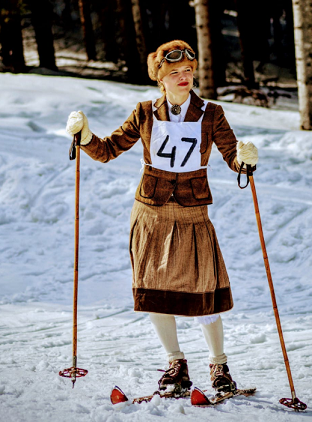 lady wearing brown dress while skiing