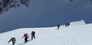 ski mountaineers hiking uphill path