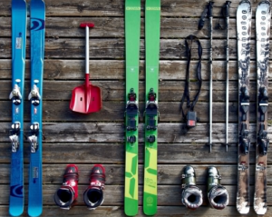 skiing gear on wooden table