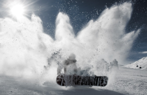 snowboarder performing a sudden stop