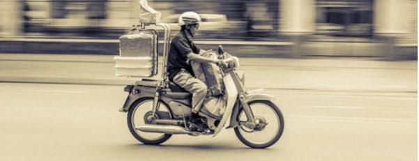 speeding scooter on a silent street