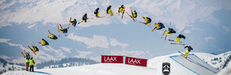 timelapse image of a snowboarder's big air jump