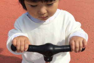 toddler riding a kids scooter