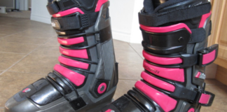 1 pair of ski boot with pink stripes