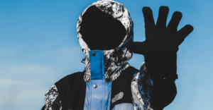 Man wearing mask and snow gloves