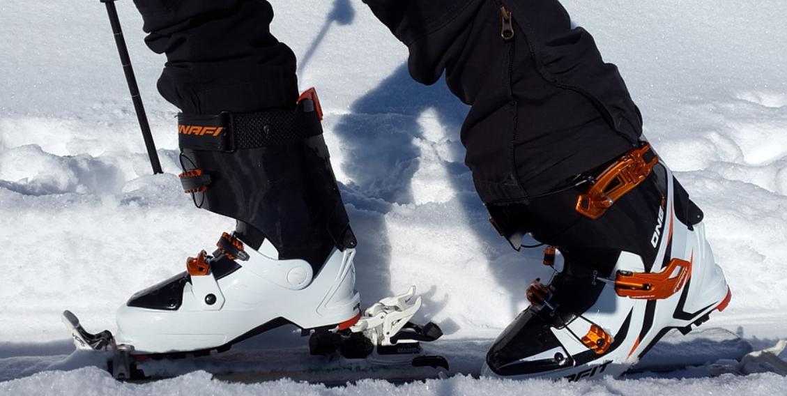 Mens foot wearing ski boots