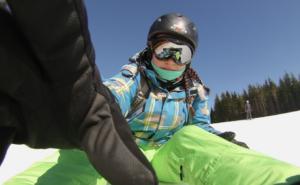 Woman taking selfie on a snow