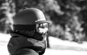 grayscale image of snowboarder wearing mask and goggles