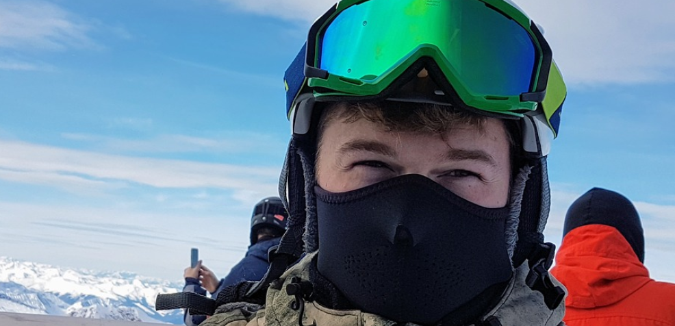 man wearing Ski Glasses mask on winter
