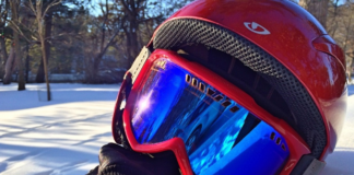 red mask with blue lenses and helmet