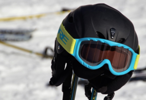 ski helmet resting on two skis