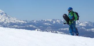 snowboarder walking uphill