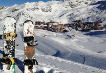 two snowboards village down bellow