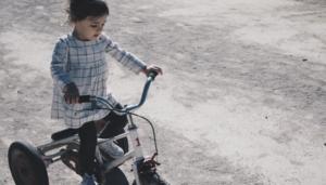 Little girl biking