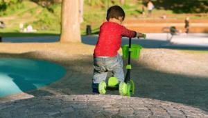 Male kid biking