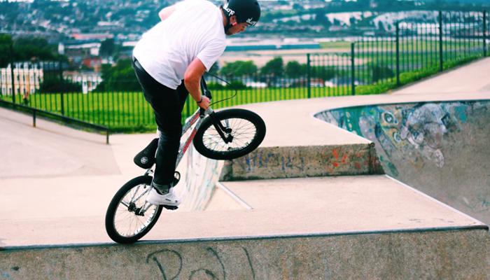 Man doing freesyle with his BMX bike