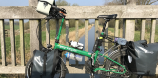 green folding bike with bag accessorries