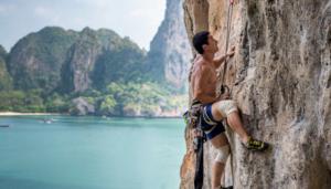 Man Climbing a mountain rock