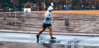 Man in hood running