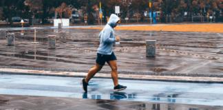 Man in hood running