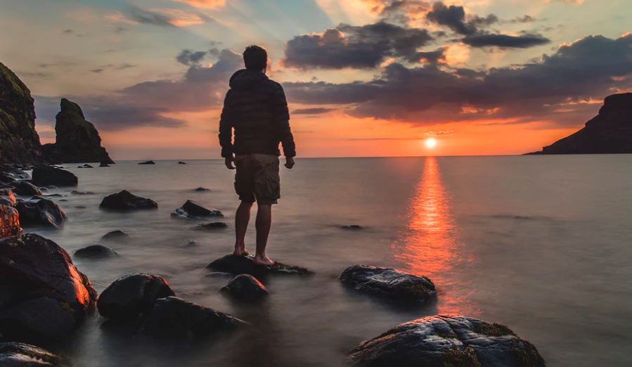 Man staring at the sunset