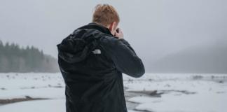 Man with black jacket taking photo