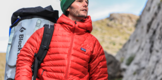 Man with hiking backpack looking up
