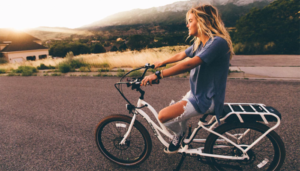 Woman riding in bicycle