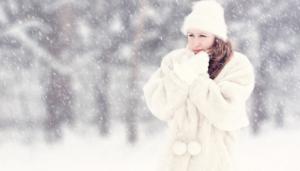 Woman wearing white winter coat