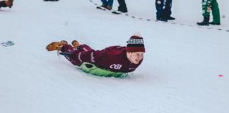 Man snow sledding