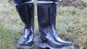 Person wearing rubber boots