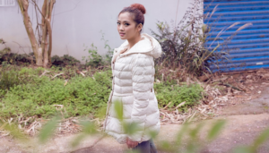 Woman wearing white down jacket